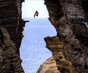 jump, sea, and rock image