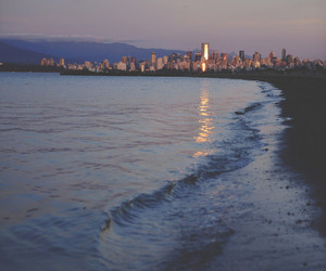 beach, city, and sea image