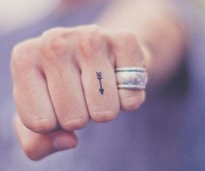 tattoo, arrow, and fingers image