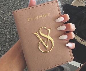 nails, passport, and vs image