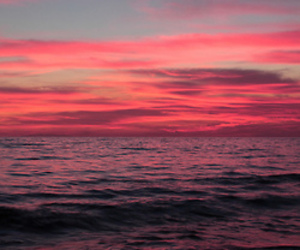 red, sea, and sky image