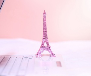 eiffel tower, laptop, and statue image