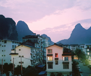 house, mountains, and sky image