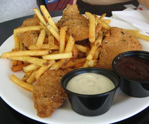 chicken fingers, fries, and chicken tenders image