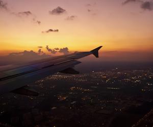sky, city, and plane image