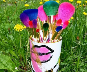 Brushes, colors, and garden image