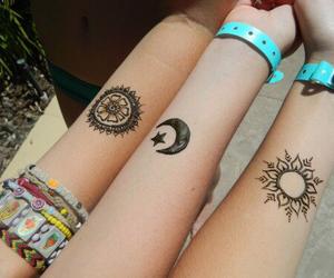 tattoo, moon, and sun image