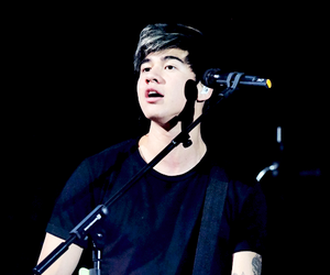 calum hood and 5sos image