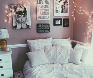 canvas, white pillows, and lights on wall image