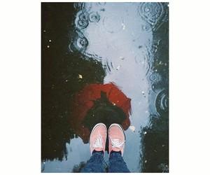 girl, paddle, and rain image