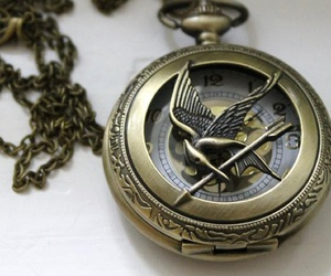 hunger games, clock, and necklace image