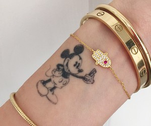 tattoo, mickey mouse, and bracelet image