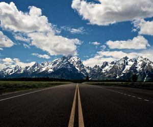 road, mountains, and clouds image