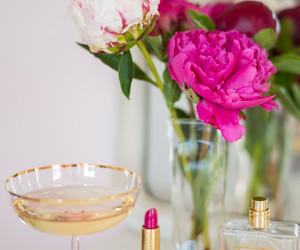 flowers, lipstick, and perfume image