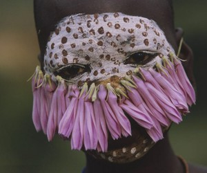 face paint, flowers, and national geographic image