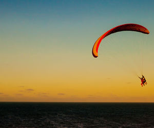 parachute, paragliding, and sunset image
