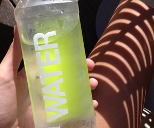water, yellow, and drink image
