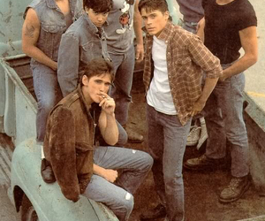 the outsiders, patrick swayze, and rob lowe image
