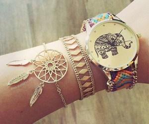 bracelet, watch, and elephant image