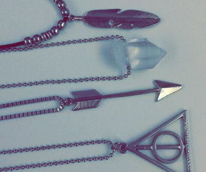 arrow, feather, and deathly hallows image