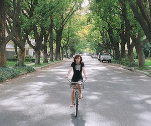 girl, bike, and trees image