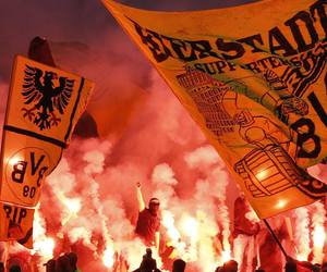 football, yellow wall, and pyro image