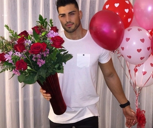 love, boy, and flowers image