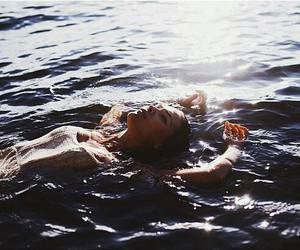 girl and floating on water image
