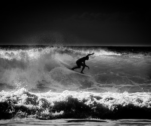 black and white, ocean, and sport image