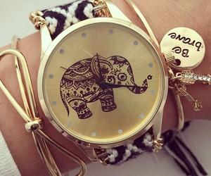 bracelets, clock, and elephant image