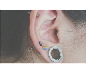 Piercings, expansor, and expandir image