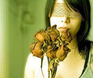 blindfold, dried flowers, and tattoo image