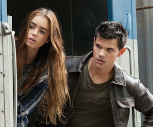 Taylor Lautner and lily collins image
