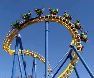 amusement park, roller-coaster, and blue sky image