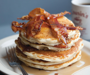 bacon, maple syrup, and pancakes image