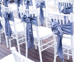 bride, chairs, and flowers image