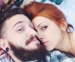 couple and redhead image