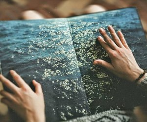 sea, book, and hands image