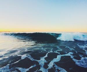 beach, waves, and sky image