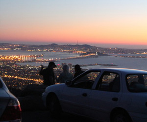 city, light, and sunset image