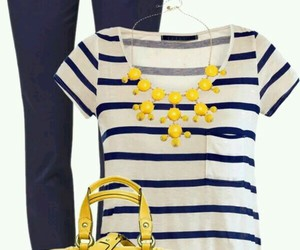 sunglasses, yellow necklace, and navy jeans image