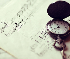music, pocket watch, and sheet music image
