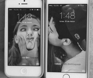couple, kiss, and phone image