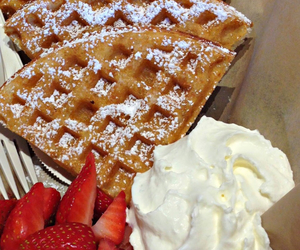 strawberries, waffles, and whipped cream image
