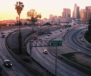 city, road, and sunset image