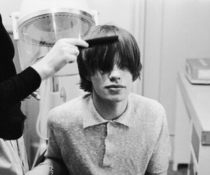 mick jagger, black and white, and hair image