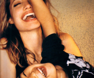 Angelina Jolie, kid, and laugh image