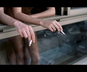 cigarettes, couple, and smoke image