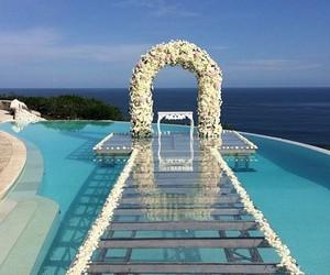 wedding, pool, and flowers image