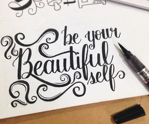 black ink, calligraphy, and quote image